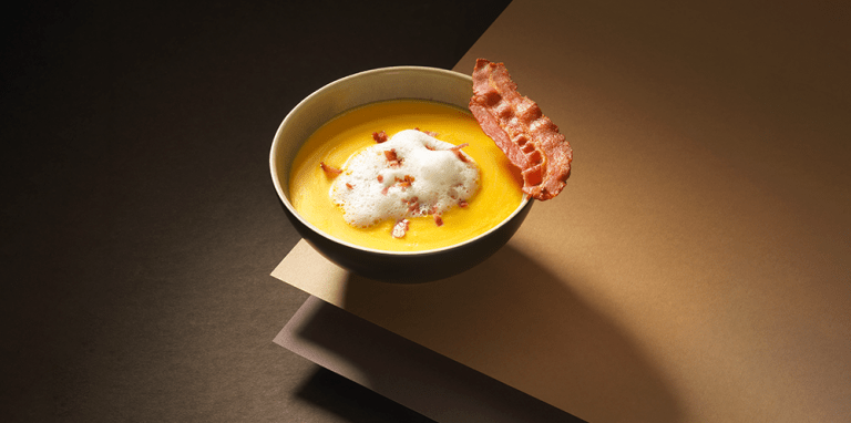 Corn soup with bacon espuma